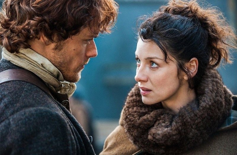 Sam Heughen and Caitriona Balfe appear as Jamie and Claire Fraser in Outlander