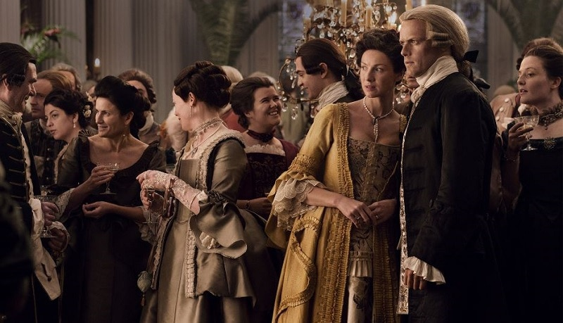Image from Season 4 of Outlander featuring Catriona Balfe as Claire and Sam Heugen as Jamie
