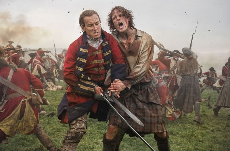 Tobias Menzies and Sam Heughen as Black Jack Randall and Jamie Fraser in Season 3 of Outlander as they depicted the Battle of Culloden