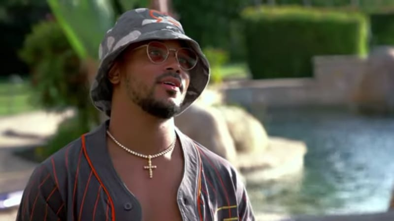 Romeo Miller outside by the pool on Growing Up Hip Hop