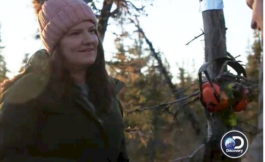Jane Kilcher cuts down a tree on Alaska: The Last Frontier