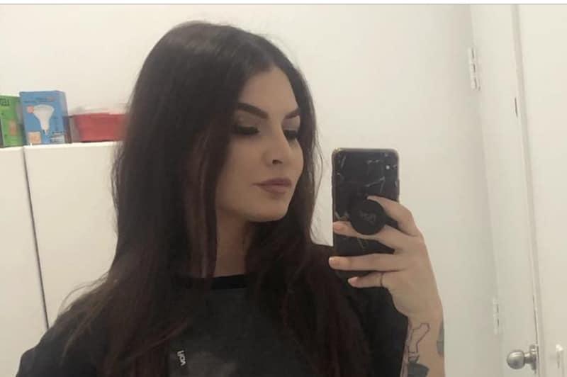 Katie Ann Martin snaps a selfie in her bathroom