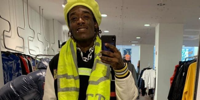 Lil Uzi Vert covers up his dreads with a yellow hat