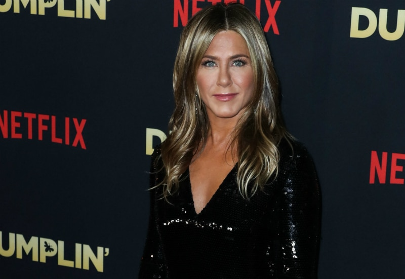 Actress Jennifer Aniston wearing a Stella McCartney dress, Fred Leighton jewelry, and a Valextra clutch arrives at the Los Angeles Premiere Of Netflix's 'Dumplin'' held at the TCL Chinese Theatre IMAX 6 on December 6, 2018 in Hollywood, Los Angeles, California,