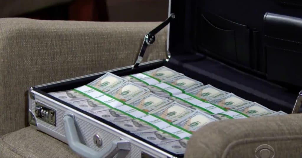 Thousands of dollars in an open suitcase