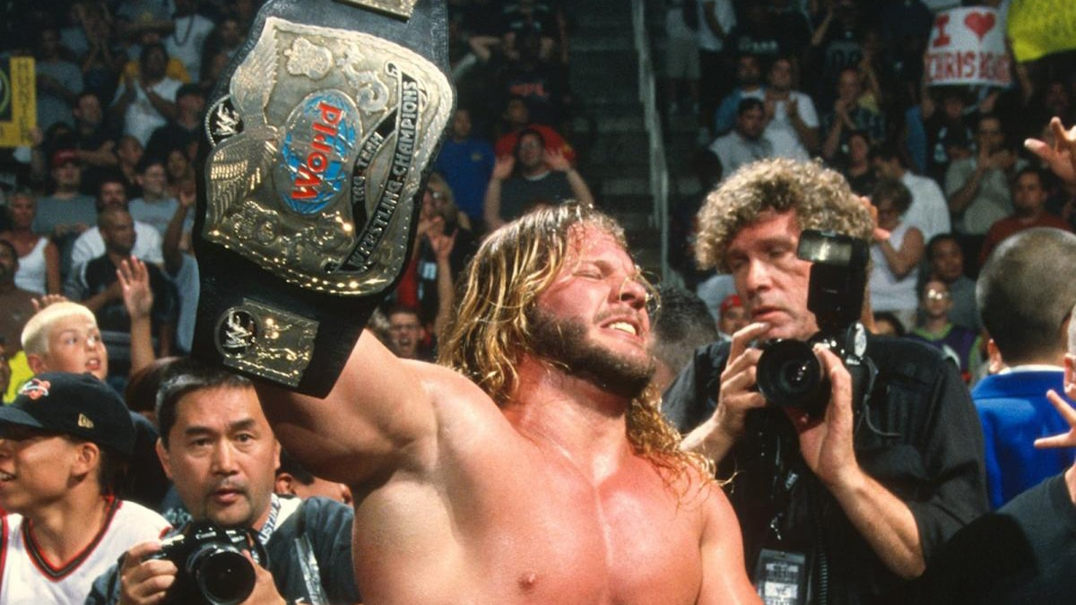 Chris Jericho holding up a title belt