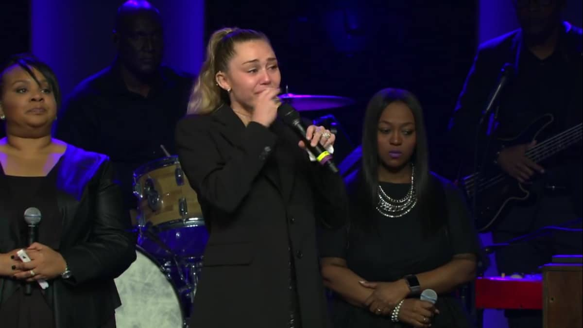 Miley Cyrus sings Amazing Grace at Janice Freeman's funeral