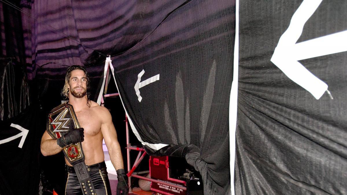 Seth Rollins backstage with a title belt