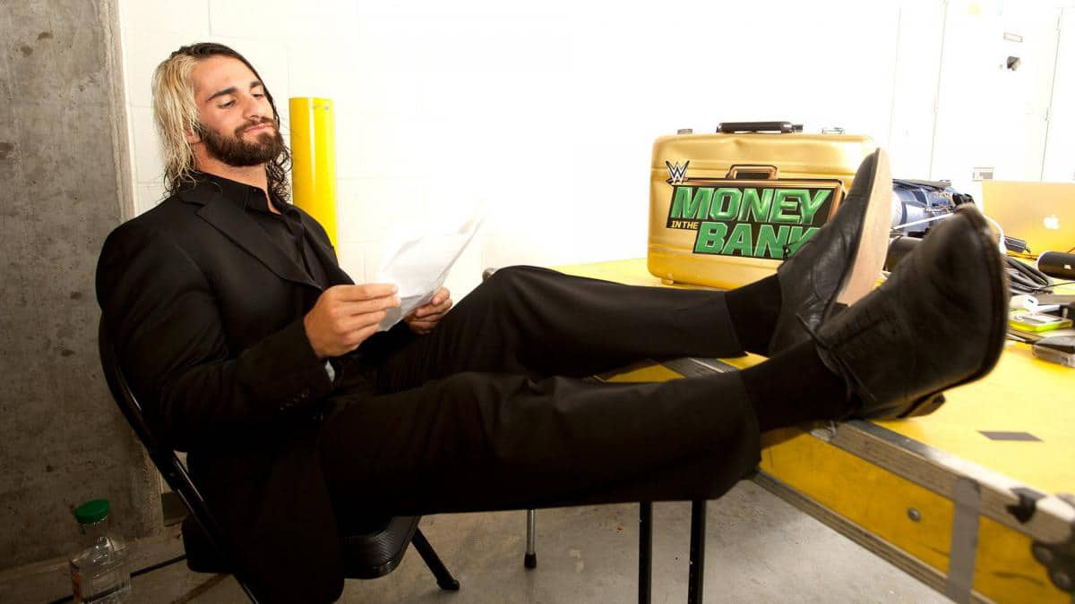 Seth Rollins kicks his feet up with his Money in the Bank briefcase