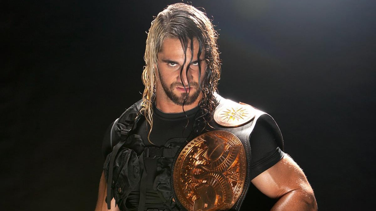 Seth Rollins with the championship belt
