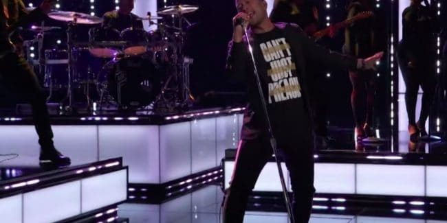 John Legend's shirt on The Voice: What is the meaning of 'Can't Just Preach'?