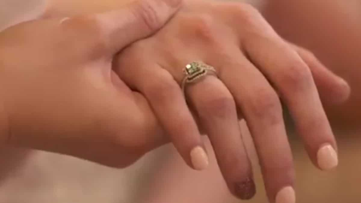 Two hands with one wearing a wedding ring from the Married at First Sight Season 9 promo