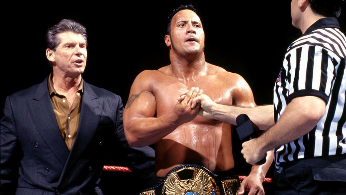 The Rock and Vince McMahon with the WWE Championship.