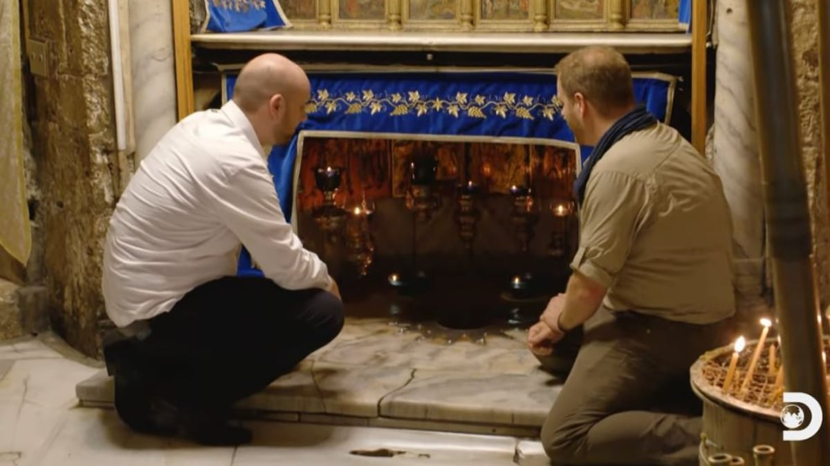 He is kneeling above the spot where the Christ child was said to have been born. Pic credit: Discovery.
