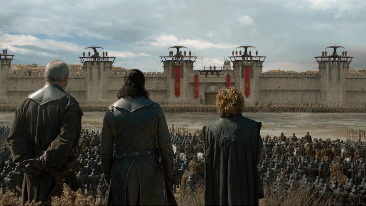 Ser Davos, Jon Snow, and Tyrion Lannister stand outside King's Landing