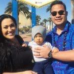 Kalani,Asuelu and their oldest son pose in Las Vegas