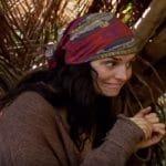 Lauren watches Aurora get caught looking through Rick's bag on Survivor.