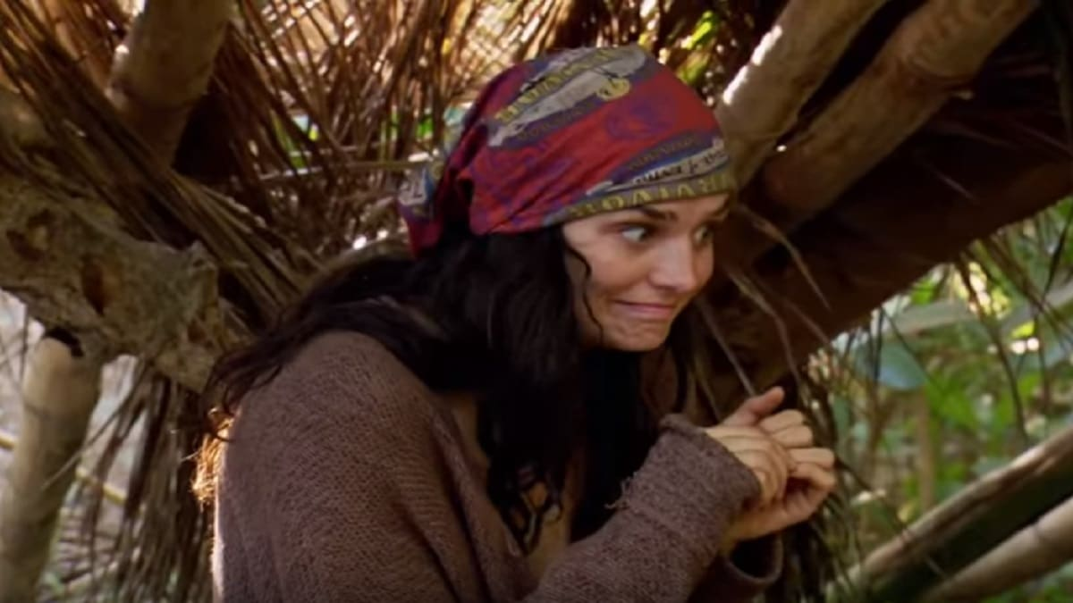 Lauren watches Aurora get caught looking through Rick's bag on Survivor.