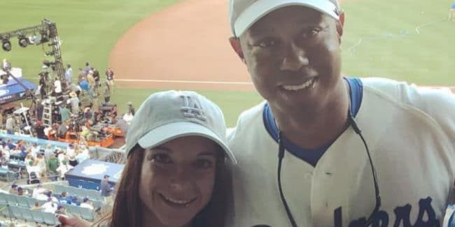 Tiger Woods and Erica Herman at a Dodgers game