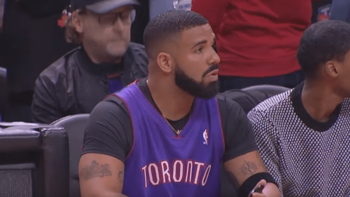 rapper drake sitting courtside at the raptors vs warriors nba finals game 1