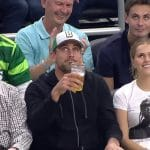 Aaron Rodgers attempts to win the beer chugging contest