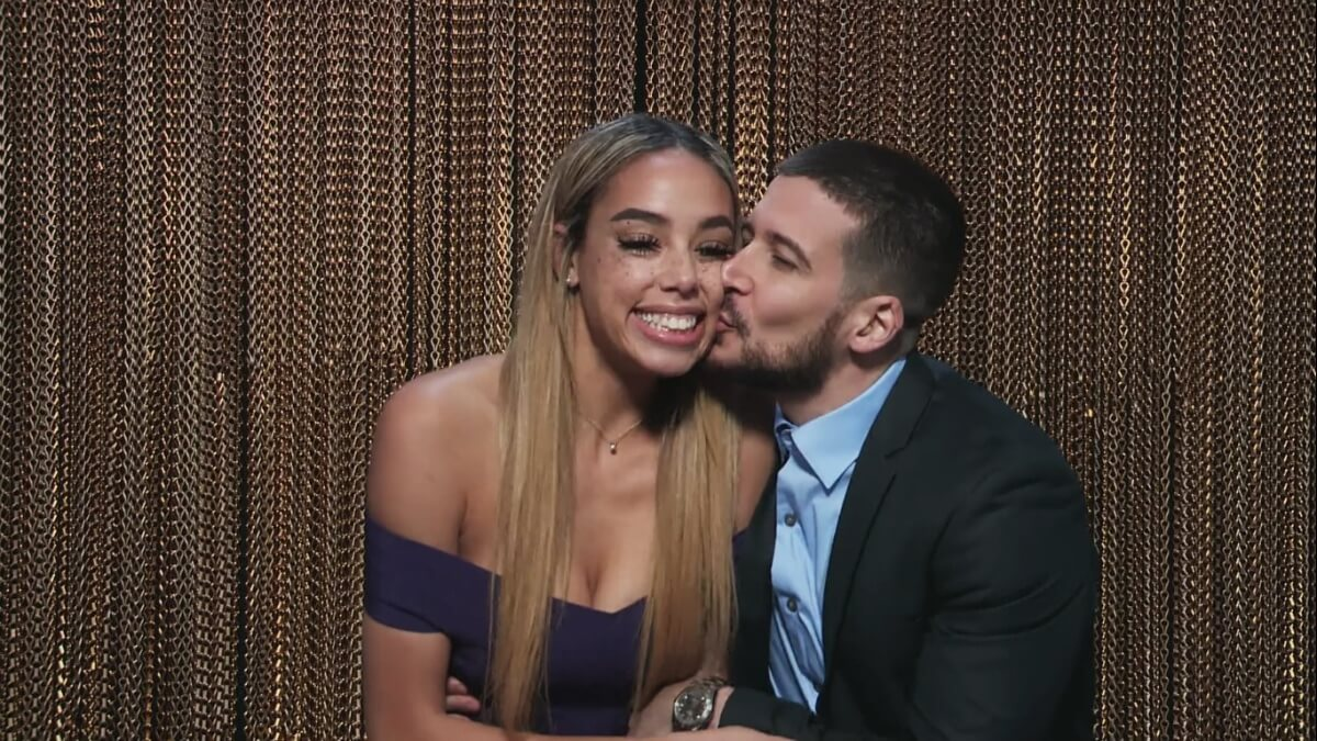 Vinny kisses Alysse on the cheek in the Double Shot at Love confessional