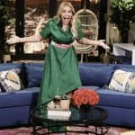 Busy Phillips posing on the set of Busy Tonight ahead of show's cancellation.