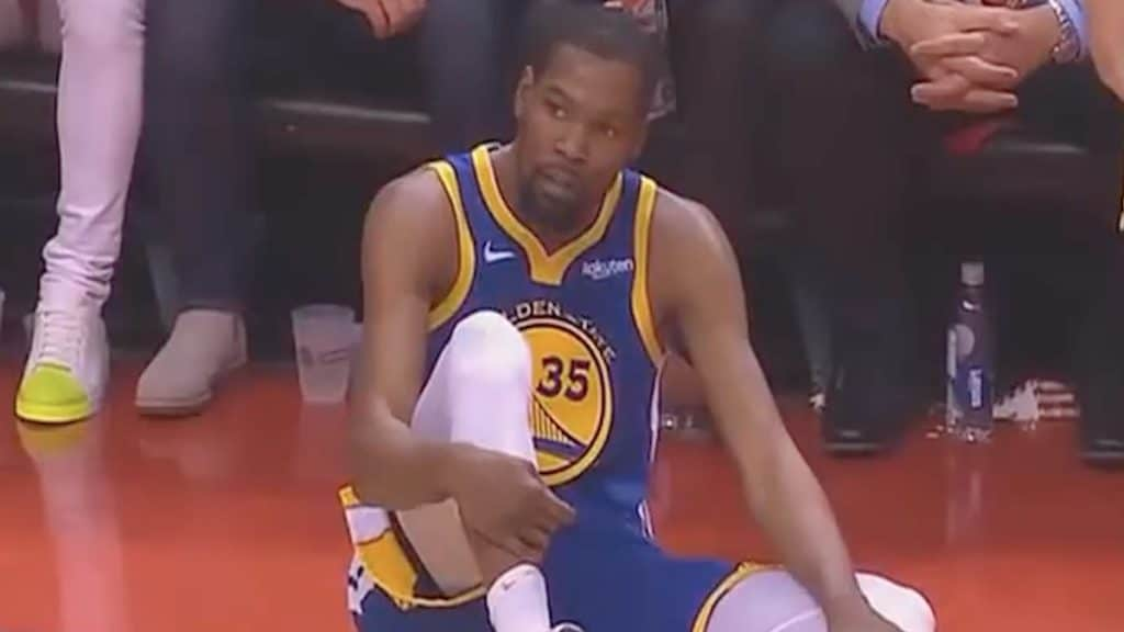 warriors star kevin durant on the court with injury in game 5