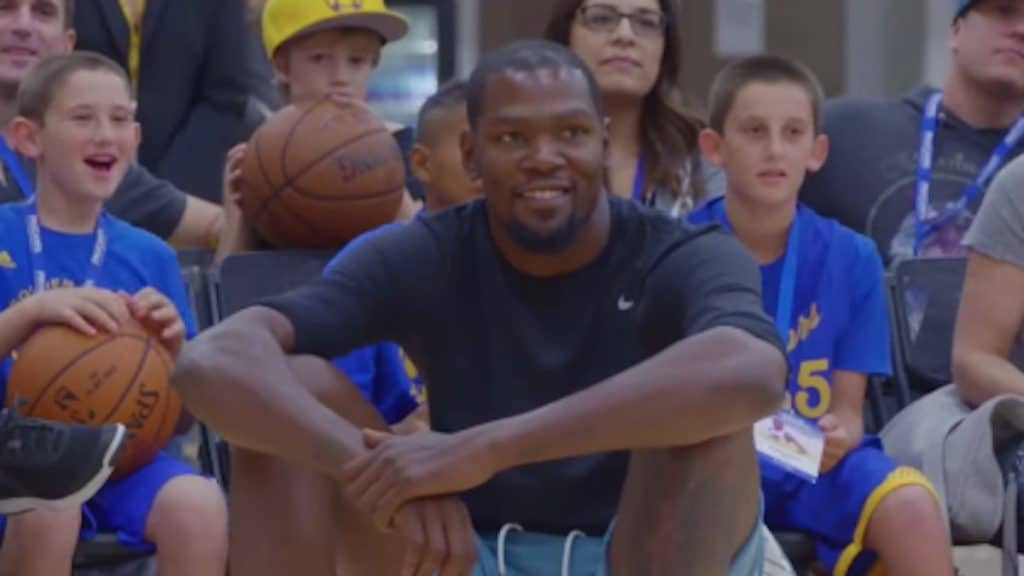 kevin durant watches with fans during basketball event