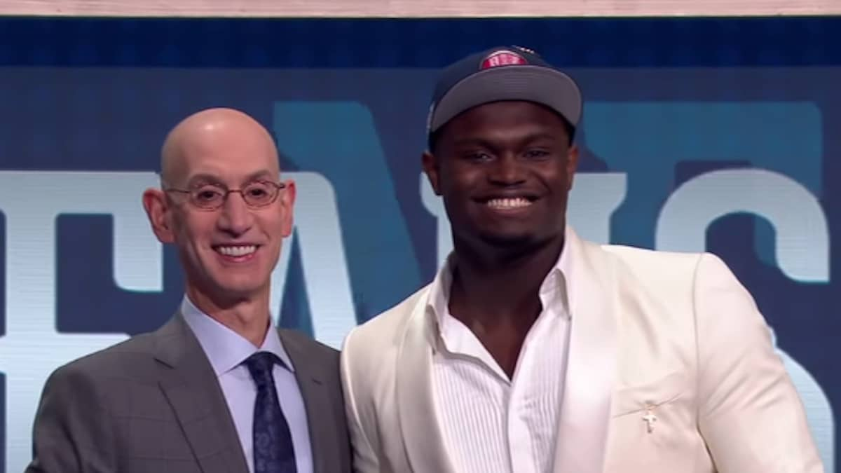 nba commissioner adam silver on stage with rookie zion williamson