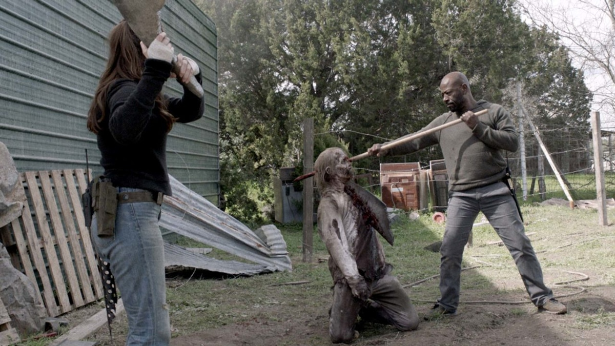 Morgan spears a zombie with a mop handle