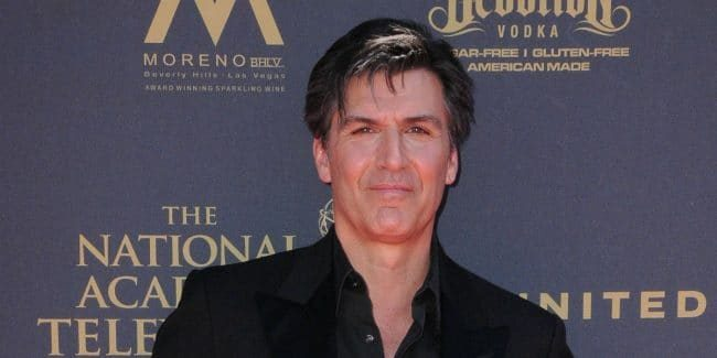 Vincent Irizarry on the red carpet at an event.