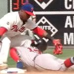 ronald acuna jr collides with jean segura while sliding into second base