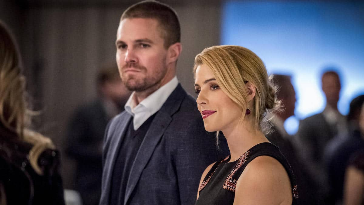 Stephen Amell as Oliver Queen and Emily Bett Rickards as Felicity on Arrow.