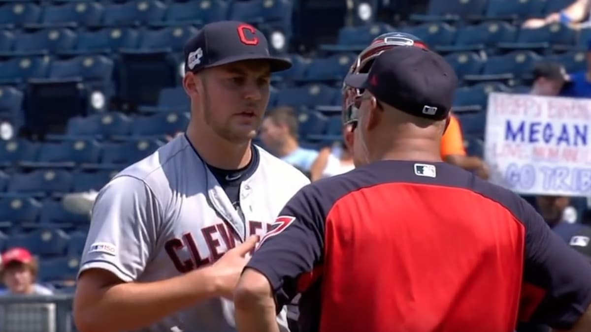 indians pitcher trevor bauer talks with manager terry francona