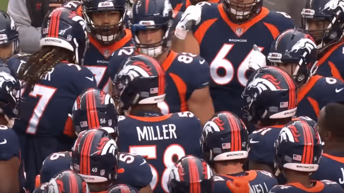 Photo of the Denver Broncos in a huddle
