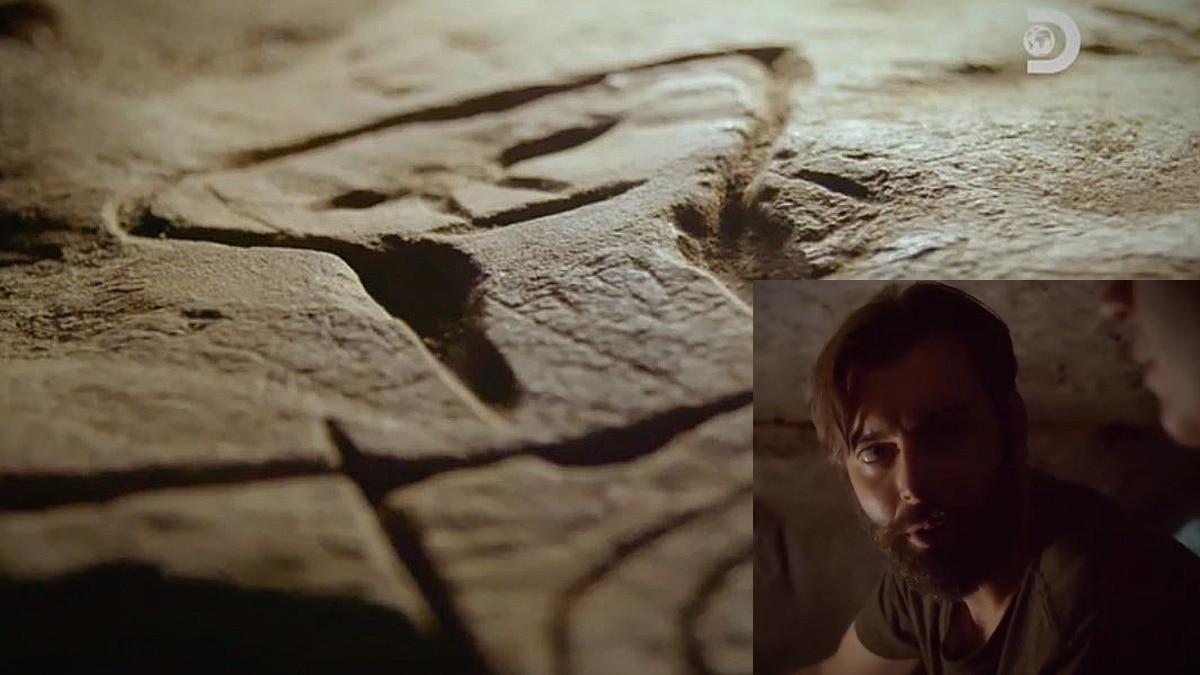 Inset photo sees Nick Karnaze look at Sarah as they venture into a cave with alleged alien carvings. Pic credit: Discovery