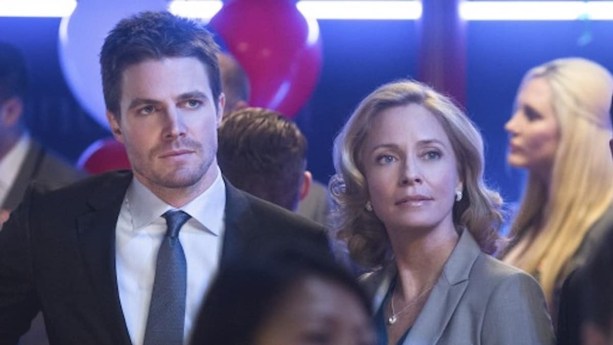 Stephen Amell as Oliver Queen and Susanna Thompson as Moira Queen in Arrow