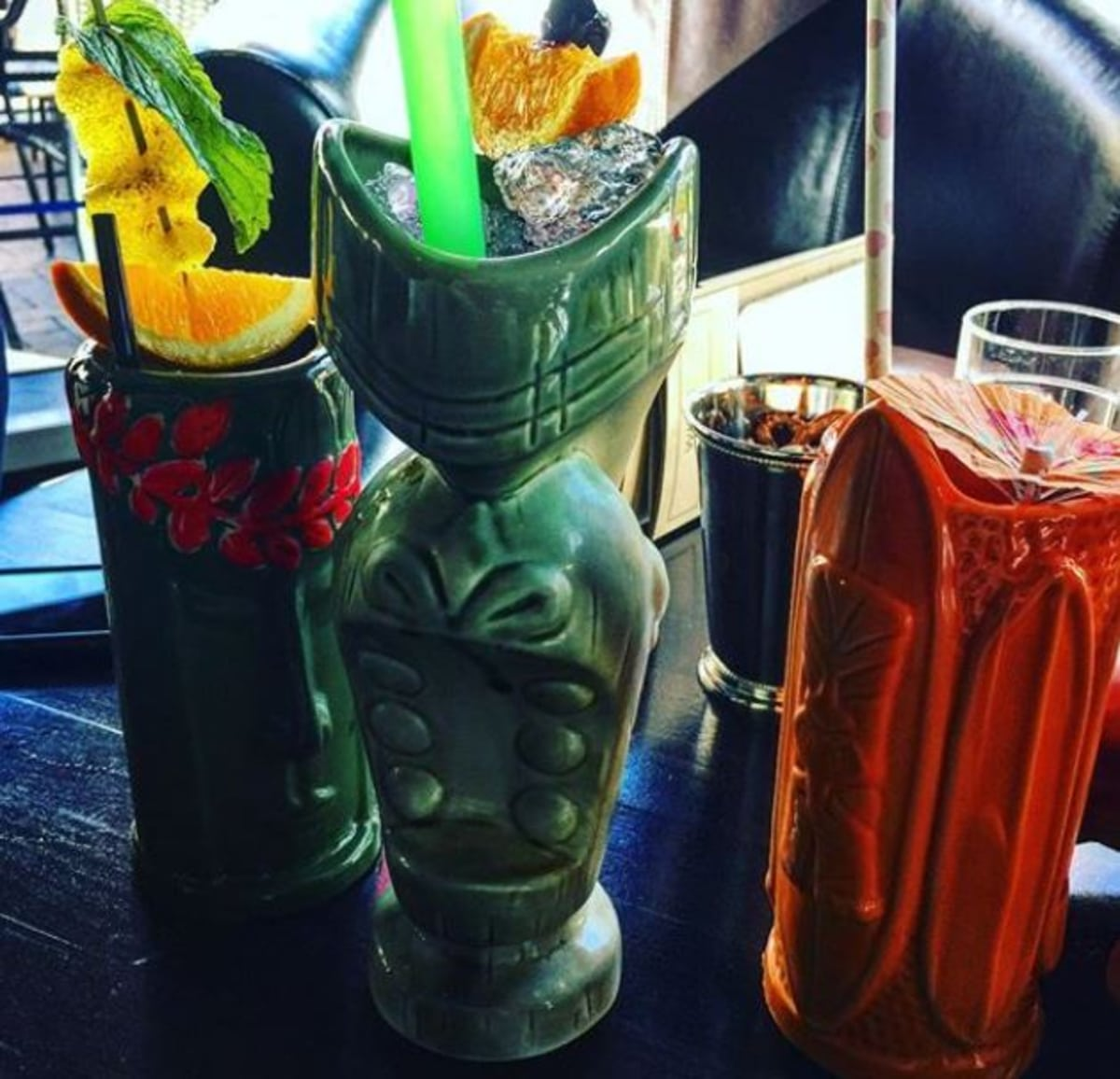 Pick any Tiki glass as long as it is a tall one for the Mai Tai or the Rye Tai, a clever swap with rye for rum. Pic credit: Monsters and Critics