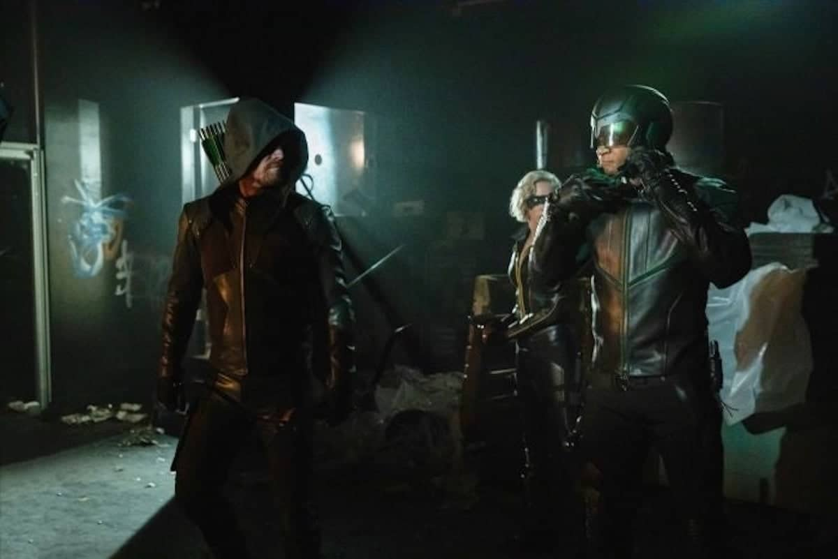 Stephen Amell as Oliver Queen/Green Arrow, Katie Cassidy as Laurel Lance/Black Siren and David Ramsey as John Diggle/Sparta on Arrow.
