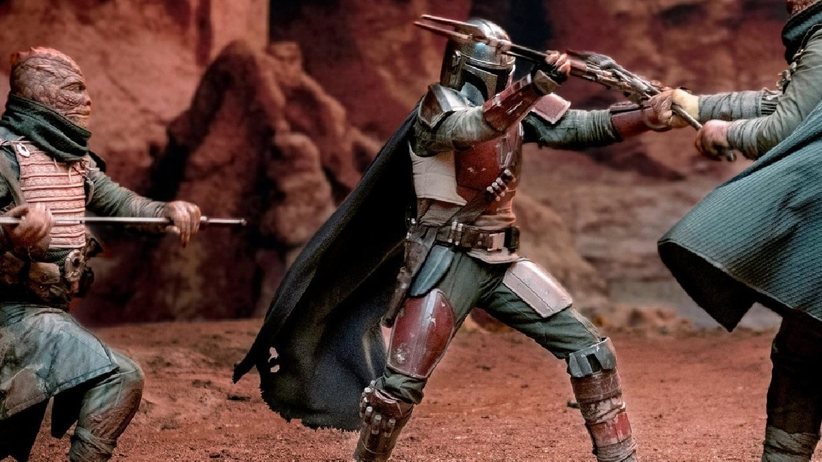 The Mandalorian takes on a pair of Trandoshans. Pic credit: Entertainment Weekly