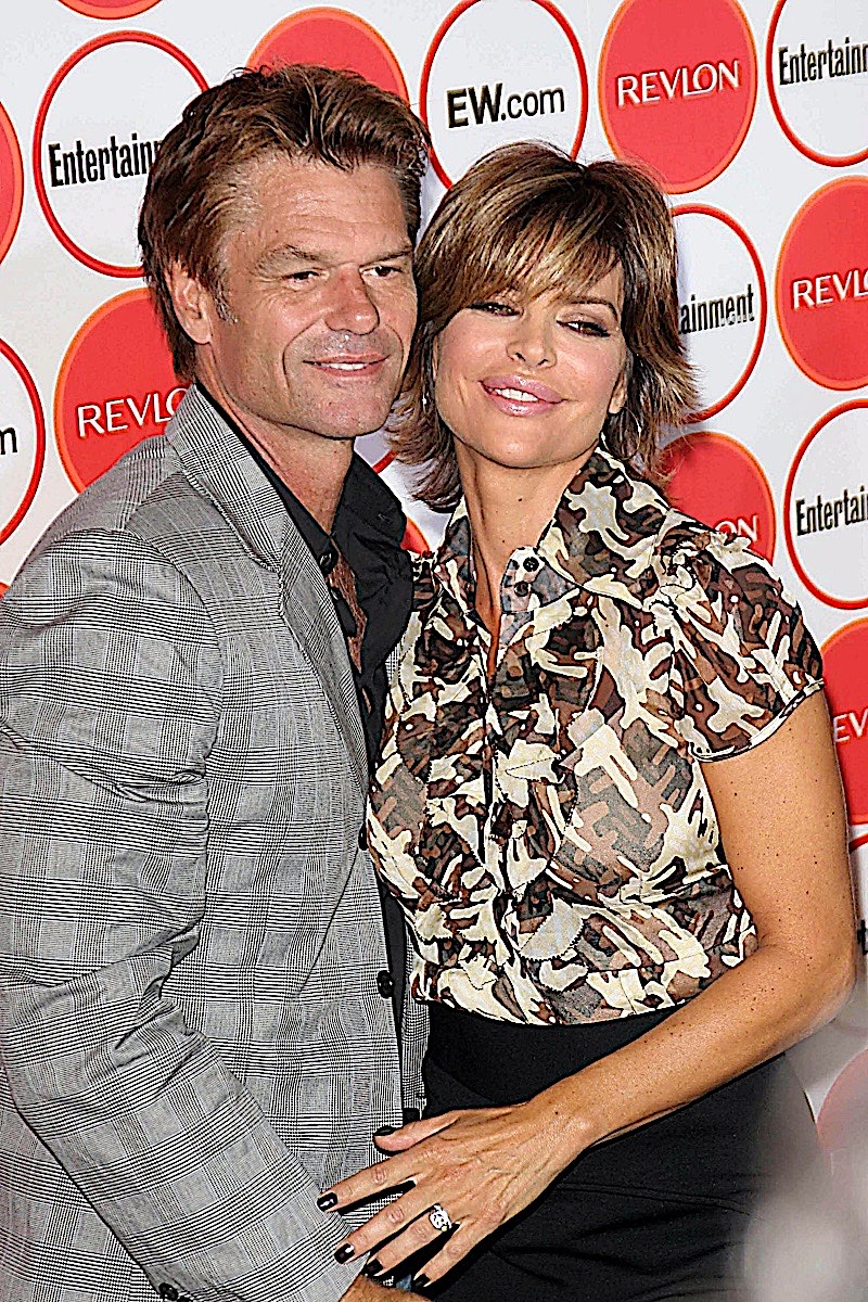 Lisa and her husband Harry pose affectionately at an event red carpet