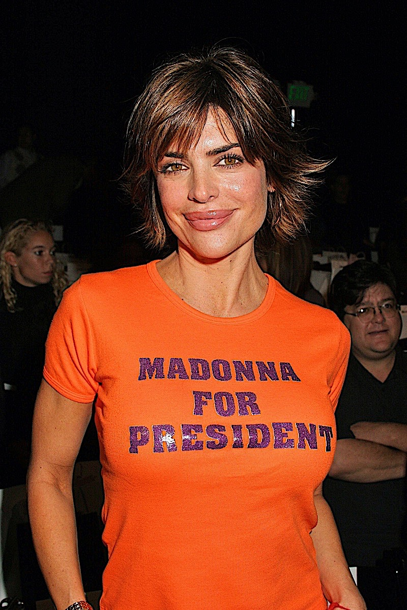 """Lisa smiling and wearing a bright orange t-shirt that reads """"Madonna for President"""""""