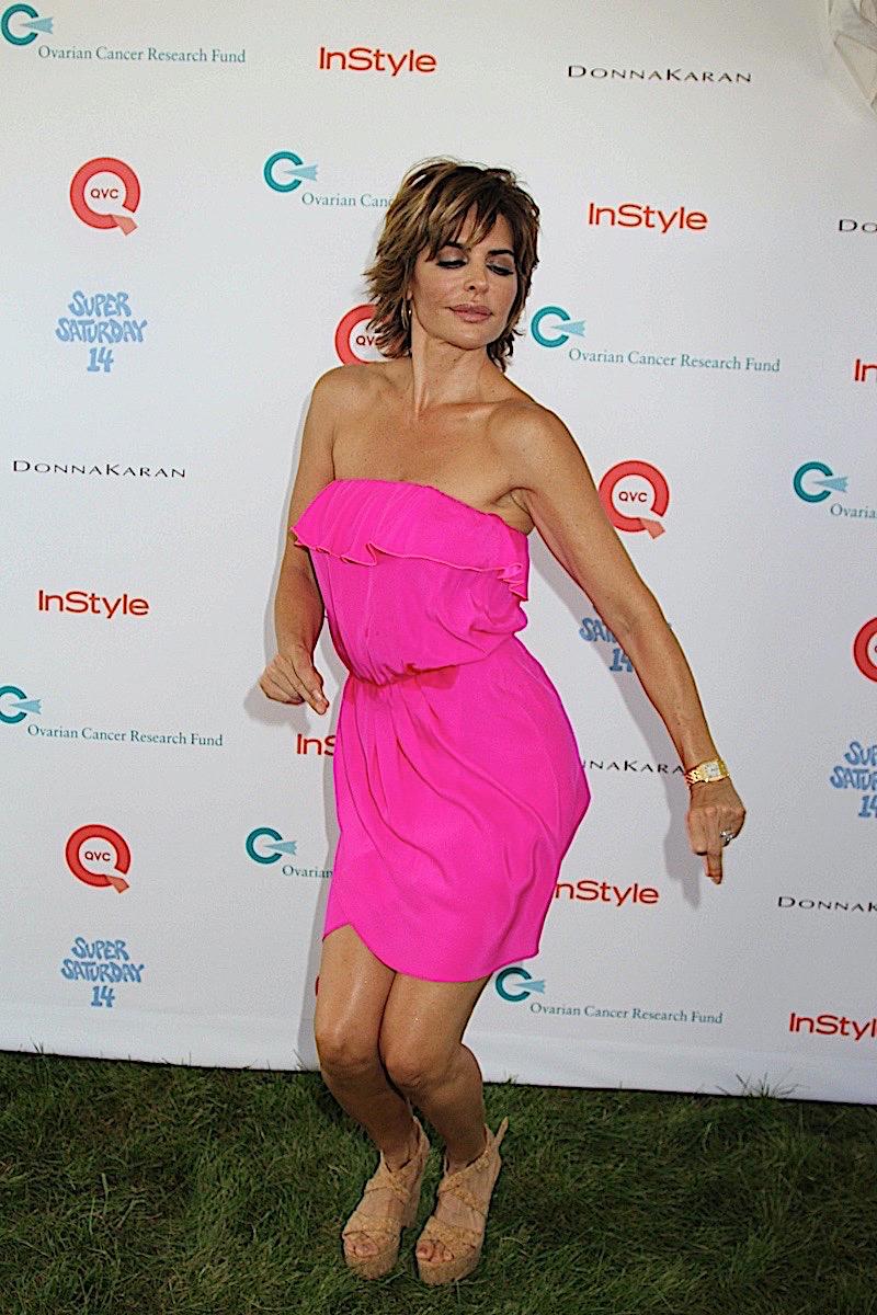 Lisa Rinna posing in a bright pink dress