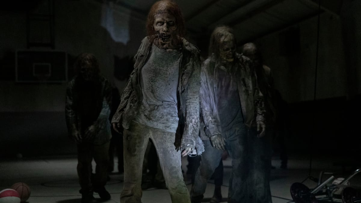 A group of walkers attack in The Walking Dead