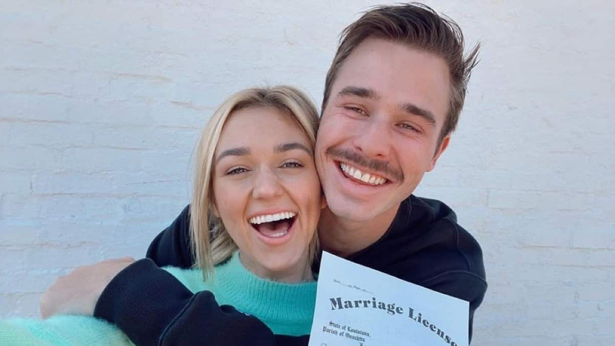 Sadie Robertson and Christian Huff posing with marriage license