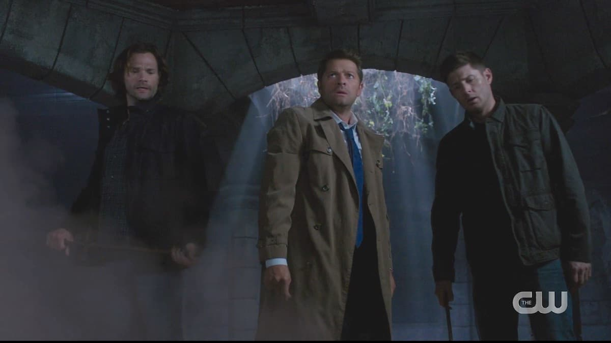 Sam, Cass, and Dean trapped in a crypt in Supernatural season 15. Pic credit: the CW
