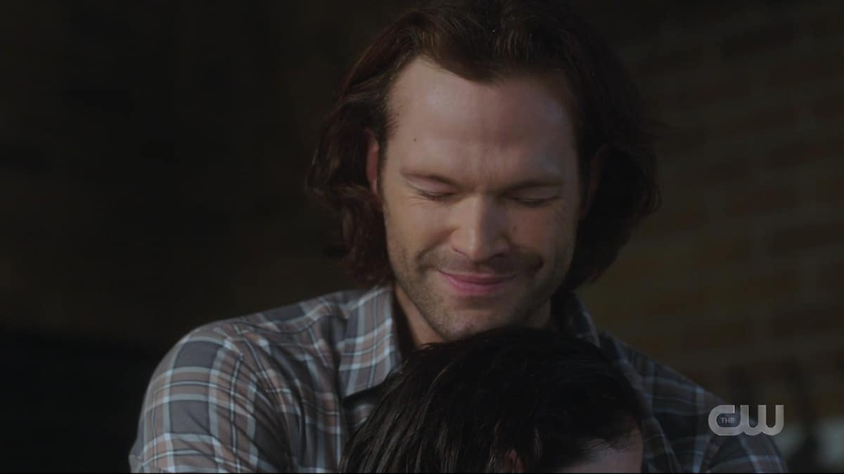 Jared Padalecki as Sam hugs Eileen after saving her with a spell. Pic credit: The CW