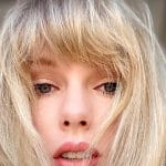 Taylor Swift posing for self shot video with fringe over face