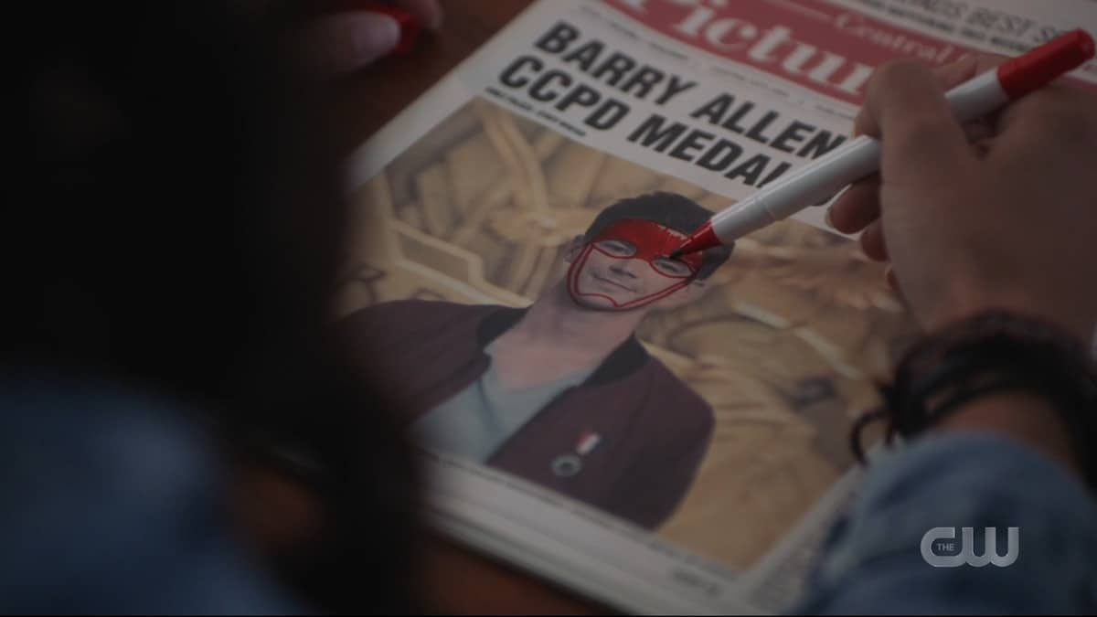 Allegra draws a Flash mask on a picture of Barry Allen. Pic credit: The CW